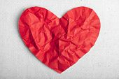 heart of red paper on canvas