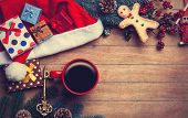 Cup Of Coffee With Pine Branch And Christmas Gifts On Wooden Background.