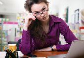 Upset Businesswoman Looking Throu Her Glasses