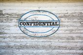 Confidential sign on shed side