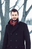 Handsome Man In Black Coat Outdoors