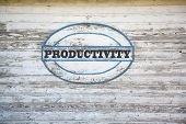 Productivity sign on shed side