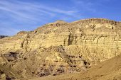 Mount Wall Of Small Crater In Negev Desert.
