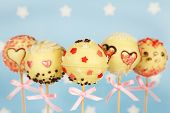 foto of cake pop  - Tasty cake pops on blue background - JPG