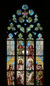 KUTNA HORA, CZECH REPUBLIC - AUGUST 23, 2014: Holy Trinity. Art Nouveau stained glass window in Saint Barbara Church in Kutna Hora, Czech Republic.
