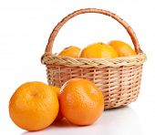 Tangerines in basket isolated on white