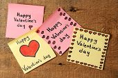 Valentines day notes on wooden background