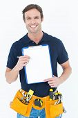 Portrait of handsome carpenter showing blank clipboard over white background