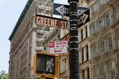 Soho Greene St sign in red light Manhattan New York City NYC USA