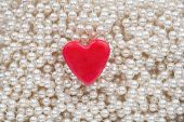 Hearts Lying On The White Beads