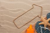 Tahiti Pointer And Beach Accessories Lying On The Sand