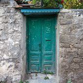 Ancient Stone Wall Green Colored Wooden Door