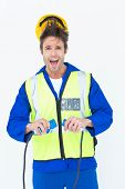 Portrait of electrician getting a shock while holding wires over white background