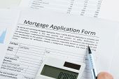 Pen And Calculator On Mortgage Application