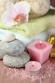 Spa treatments with orchid flower on wooden table on colorful background