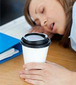 Languorous Woman Sleeping On Table In Office