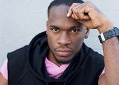 image of swagger  - Close up portrait of a handsome young black man - JPG