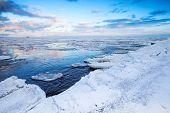 Winter Coastal Landscape With Floating Ice Fragments