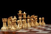 stock photo of chessboard  - chess pieces on chessboard against black background - JPG