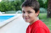 portrait of little boy with red shirt, outdoor