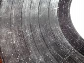 picture of analogy  - Badly damaged scratched vinyl record vintage analog music recording medium - JPG