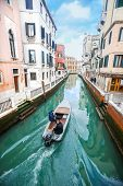 Boat Sailing In Italian Water Channel