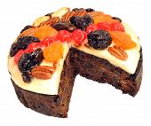 image of brazil nut  - Fruit cake decorated with glazed fruit and nuts isolated on a white background - JPG