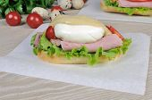 Sandwich With Ham And Poached Egg.