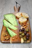 Olives Provencal, Solid Cheeses Plate, Walnuts And Slices Of Baguette