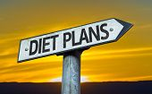 Diet Plans sign with a sunset background