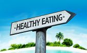 Healthy Eating sign with a beach on background