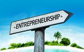 Entrepreneurship sign with a beach on background