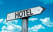 Hotel sign with sky background