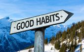 Good Habits sign with winter background