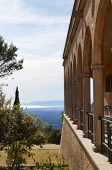 stock photo of greek-architecture  - Greek architecture balcony with view of the mediterranean sea - JPG