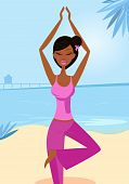 Woman in yoga tree pose on the sunny beach