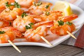 picture of braai  - Delicious fried shrimp on wooden skewers close - JPG