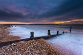 Groynes At Sunset In Milford-on-sea