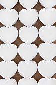 White heart shaped porcelain bowls in abstract design.