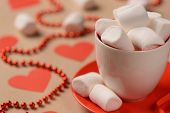 Closeup of marshmallows placed in the cup and saucer