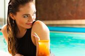 Lovely Woman With Cocktail Glass In Water