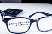 Business Plan Words See Through Glasses Lens Near Calculator, Business Concept
