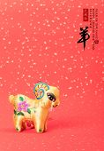 chinese goat toy on red background
