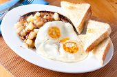 Two Eggs Over Easy, Sausage, Hashbrowns And Toast