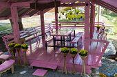 foto of gazebo  - pink wooden gazebo decorating with yellow flower pot - JPG