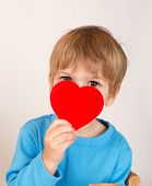 Child Holding A Valentine's Day Heart