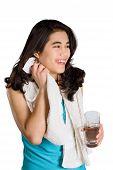 Beautiful Biracial Teenage Girl Drinking Water While Wiping Off Sweat