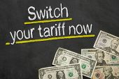 Text on blackboard with money - Switch your tariff now