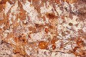 Rust colors closeup marble texture.