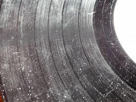 foto of analogy  - Badly damaged scratched vinyl record vintage analog music recording medium - JPG